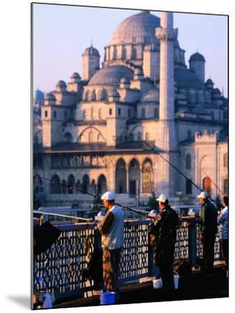 Fishermen on Galata Bridge with Mosque in Background, Istanbul, Turkey-John Elk III-Mounted Photographic Print