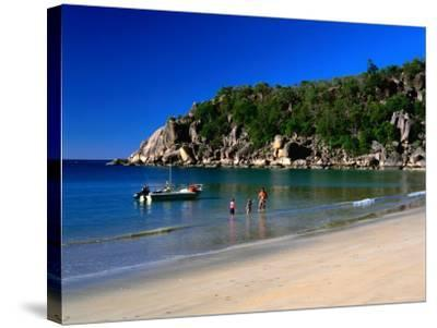 Father and Daughters Enjoying Waters of Radical Bay, Magnetic Island, Australia-Ross Barnett-Stretched Canvas Print