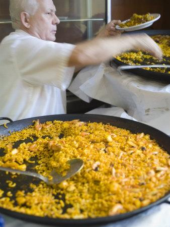 Man Serving Paella, with Noodle Paella in Foreground, Central, Valencia, Spain-Greg Elms-Stretched Canvas Print
