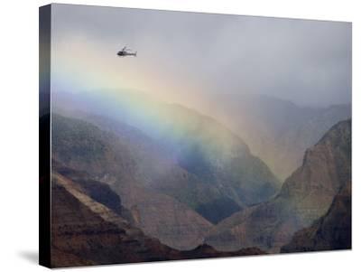 Helicopter and Rainbow at Waimea Canyon, Waimea Canyon State Park, Kauai, Hawaii-Holger Leue-Stretched Canvas Print
