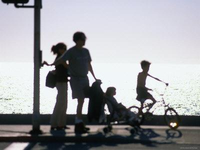 Family Takes an Early Evening Stroll along Redondo Beach in Los Angeles, Los Angeles, California-Ray Laskowitz-Framed Photographic Print