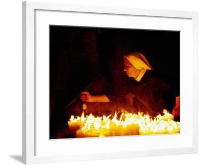 Nun Attending Candles at Stone Gate Shrine, Zagreb, City of Zagreb, Croatia-Richard I'Anson-Framed Photographic Print