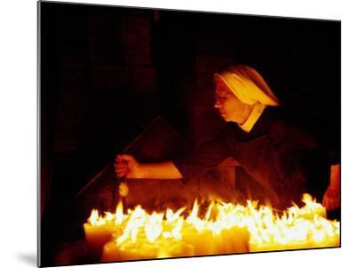 Nun Attending Candles at Stone Gate Shrine, Zagreb, City of Zagreb, Croatia-Richard I'Anson-Mounted Photographic Print