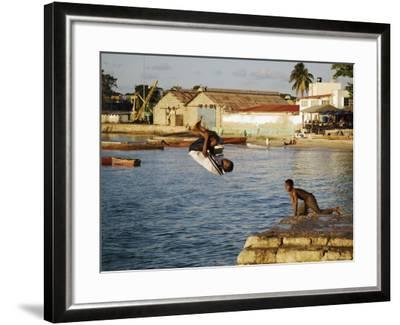 Children Diving in Sea at Waterfront, Stone Town, Zanzibar Town, Zanzibar West, Tanzania-Ariadne Van Zandbergen-Framed Photographic Print