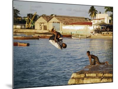 Children Diving in Sea at Waterfront, Stone Town, Zanzibar Town, Zanzibar West, Tanzania-Ariadne Van Zandbergen-Mounted Photographic Print