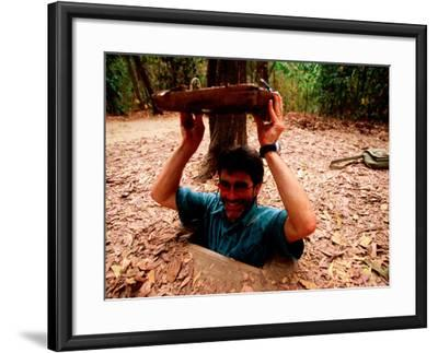American Visitor Explores Tunnel at Former War Time Cu Chi Tunnel System, Ho Chi Minh, Vietnam-Stu Smucker-Framed Photographic Print