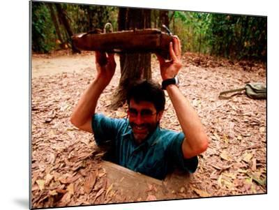 American Visitor Explores Tunnel at Former War Time Cu Chi Tunnel System, Ho Chi Minh, Vietnam-Stu Smucker-Mounted Photographic Print