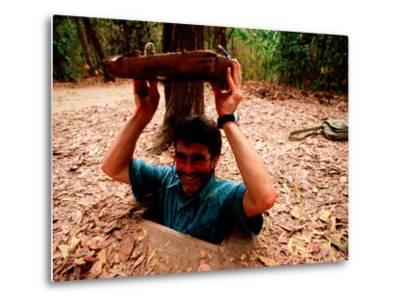 American Visitor Explores Tunnel at Former War Time Cu Chi Tunnel System, Ho Chi Minh, Vietnam-Stu Smucker-Metal Print