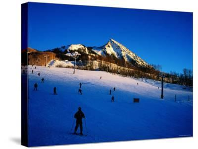 Skiers at Mt. Crested Butte, Crested Butte, Colorado-Holger Leue-Stretched Canvas Print