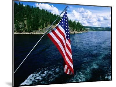American Flag on Boat, Lake Coeur d'Alene, Coeur d'Alene, Idaho-Holger Leue-Mounted Photographic Print