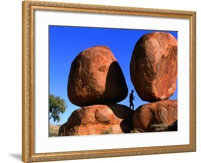 Man Standing in Between Boulders, Devil's Marbles Conservation Reserve, Australia-John Banagan-Framed Photographic Print