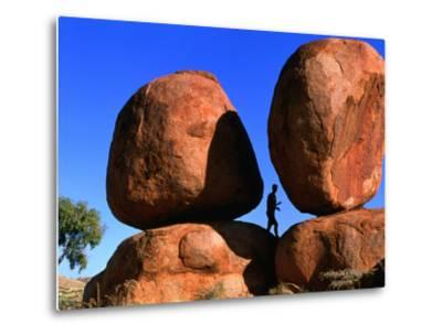Man Standing in Between Boulders, Devil's Marbles Conservation Reserve, Australia-John Banagan-Metal Print