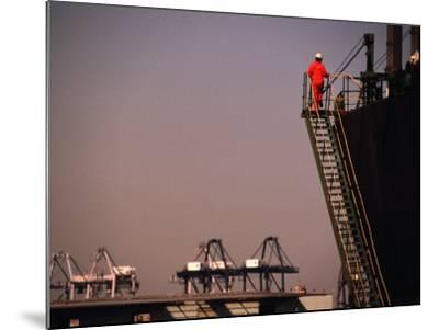 Crew Member Entering Cargo Ship on Ladder, Los Angeles, California-Thomas Winz-Mounted Photographic Print