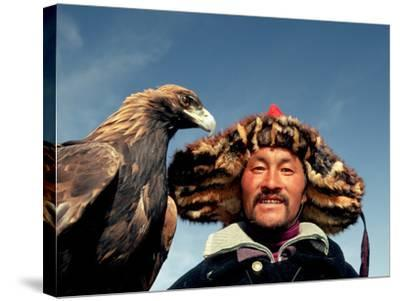 Takhuu Head Eagle Man, Altai Sum, Golden Eagle Festival, Mongolia-Amos Nachoum-Stretched Canvas Print