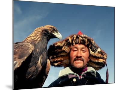 Takhuu Head Eagle Man, Altai Sum, Golden Eagle Festival, Mongolia-Amos Nachoum-Mounted Photographic Print