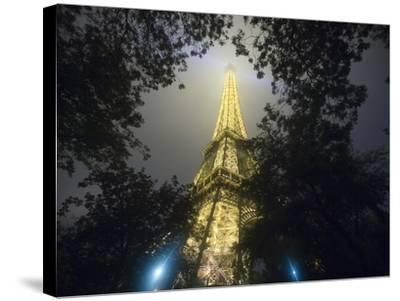 Nighttime View Looking up at Eiffel Tower, Paris, France-Jim Zuckerman-Stretched Canvas Print