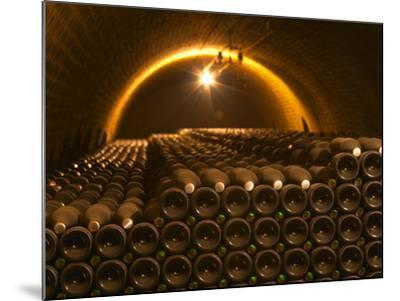 Champagne Bottles in Vaulted Cellar, Champagne Deutz, Ay, Vallee De La Marne, Ardennes, France-Per Karlsson-Mounted Photographic Print
