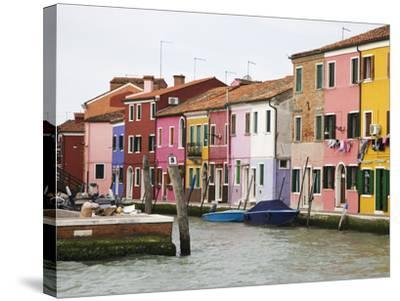 Boats and Colorful Homes in Canal, Burano, Italy-Dennis Flaherty-Stretched Canvas Print