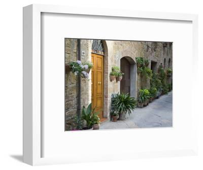 Flower Pots and Potted Plants Decorate a Narrow Street in Tuscan Village, Pienza, Italy-Dennis Flaherty-Framed Photographic Print