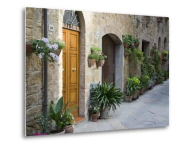 Flower Pots and Potted Plants Decorate a Narrow Street in Tuscan Village, Pienza, Italy-Dennis Flaherty-Metal Print