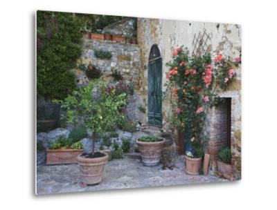 Potted Plants Decorate a Patio in Tuscany, Petroio, Italy-Dennis Flaherty-Metal Print