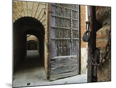 Wooden Fortified Gates and Alley of Medieval Town, Buonconvento, Italy-Dennis Flaherty-Mounted Photographic Print
