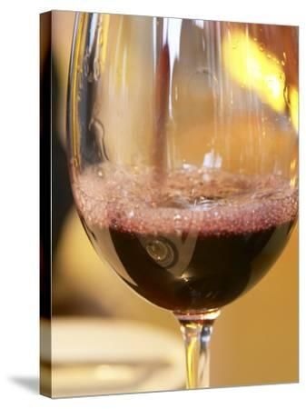 Glass of Red Wine, Restaurant Red at Hotel Madero Sofitel, Puerto Madero, Buenos Aires, Argentina-Per Karlsson-Stretched Canvas Print