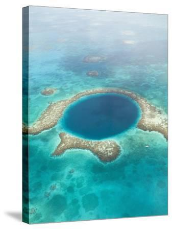 Aerial of Blue Hole, Sailboat Anchored, Lighthouse Atoll, Belize-Stuart Westmoreland-Stretched Canvas Print