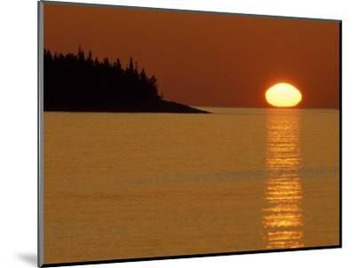 Spring Sunrise Silhouettes Edwards Island and Reflects Light on Lake Superior-Mark Carlson-Mounted Photographic Print