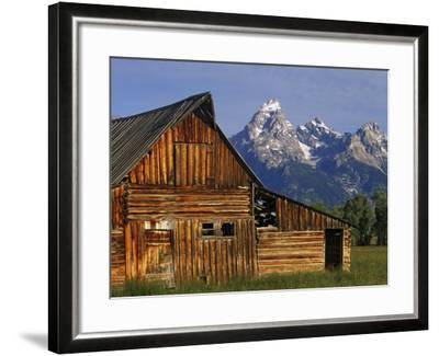 Weathered Wooden Barn Along Mormon Row with the Grand Tetons in Distance, Grand Teton National Park-Dennis Flaherty-Framed Photographic Print