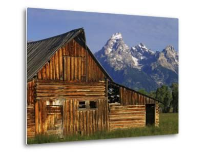 Weathered Wooden Barn Along Mormon Row with the Grand Tetons in Distance, Grand Teton National Park-Dennis Flaherty-Metal Print