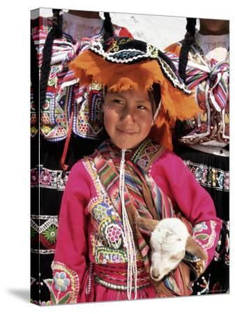 Portrait of a Local Smiling Peruvian Girl in Traditional Dress, Holding a Young Animal, Cuzco, Peru-Gavin Hellier-Stretched Canvas Print