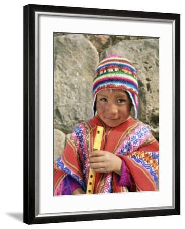 portrait of a peruvian boy in a knitted hat playing the flute near cuzco peru south america. Black Bedroom Furniture Sets. Home Design Ideas
