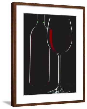 Studio Shot of Back-Lit Glass and Bottle of Red Wine-Lee Frost-Framed Photographic Print
