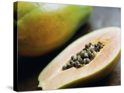 Papaya (Pawpaw) Sliced Open to Show Black Seeds-Lee Frost-Stretched Canvas Print