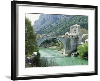 The Turkish Bridge Over the River Neretva Dividing the Town, Mostar, Bosnia, Bosnia-Herzegovina-Michael Short-Framed Photographic Print