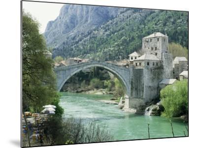 The Turkish Bridge Over the River Neretva Dividing the Town, Mostar, Bosnia, Bosnia-Herzegovina-Michael Short-Mounted Photographic Print