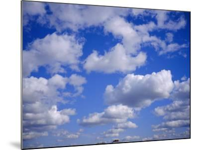 Blue Sky and Puffy White Clouds-Fraser Hall-Mounted Photographic Print