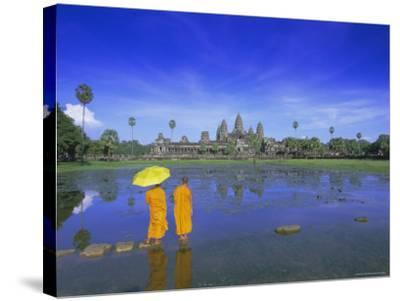 Buddhist Monks Standing in Front of Angkor Wat, Siem Reap, Cambodia-Gavin Hellier-Stretched Canvas Print