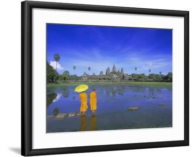 Buddhist Monks Standing in Front of Angkor Wat, Siem Reap, Cambodia-Gavin Hellier-Framed Photographic Print