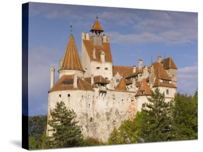 Bran Castle Perched Atop a 60M Peak in the Centre of the Village, Saxon Land, Transylvania-Gavin Hellier-Stretched Canvas Print