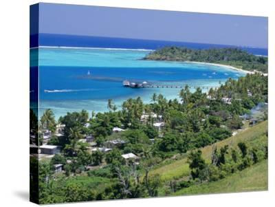 Resort Huts Beside Coral Sand Beach, Fiji, South Pacific Islands-Anthony Waltham-Stretched Canvas Print