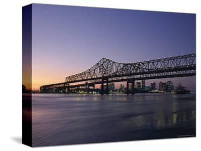 Mississippi River Bridge in the Evening and City Beyond, New Orleans, Louisiana-Charles Bowman-Stretched Canvas Print