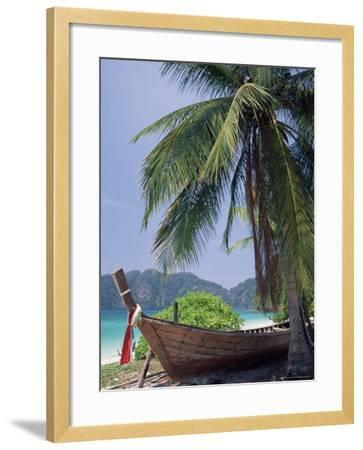 Wooden Boat Beneath Palm Trees on Beach, off the Island of Phuket, Thailand-Ruth Tomlinson-Framed Photographic Print