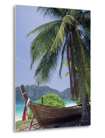 Wooden Boat Beneath Palm Trees on Beach, off the Island of Phuket, Thailand-Ruth Tomlinson-Metal Print