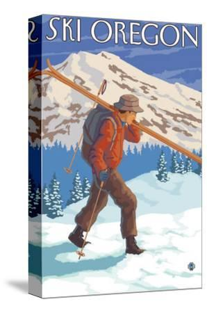 Skier Carrying Snow Skis, Oregon-Lantern Press-Stretched Canvas Print