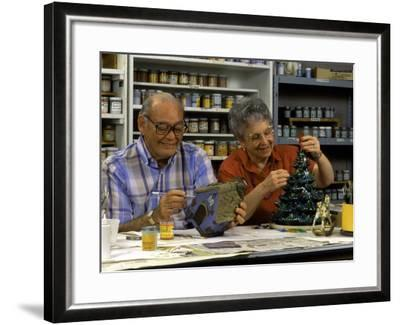 Retired Couple Making Ceramics in Art Class-Bill Bachmann-Framed Photographic Print