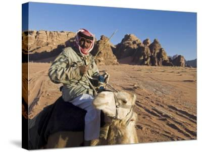 Bedouin on Camel in the Desert, Wadi Rum, Jordan, Middle East-Sergio Pitamitz-Stretched Canvas Print
