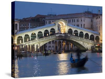 The Grand Canal, the Rialto Bridge and Gondolas at Night, Venice, Veneto, Italy-Christian Kober-Stretched Canvas Print