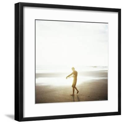 Young Man Waxes His Board Before Entering Marabella's Waves, Costa Rica, Central America-Aaron McCoy-Framed Photographic Print
